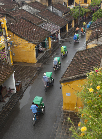 tran: Hoi An, Vietnam - Jun 21, 2015: View from above of Tran Phu street in Hoi An ancient town on a rainy day. Hoi An is recognized as a world heritage site by UNESCO.