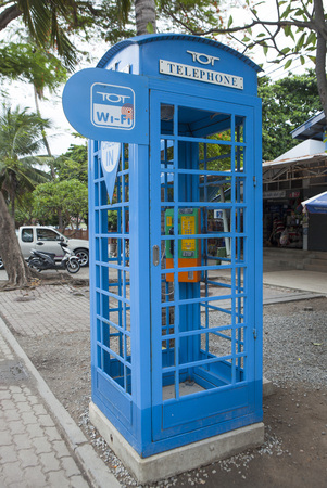 public company: Pattaya, Thailand - Jul 17, 2015: Close up of a telephone booth and wi-fi pot of TOT on a street. TOT Public Company Limited offers telecommunications and other related services in Thailand.