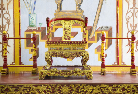 world cultural heritage: Close up of the sample of King Chair in the Forbidden City of the Imperial Royal Palace of Nguyen dynasty - a World Cultural Heritage site recognized by UNESCO.