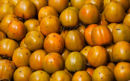 Ripe persimmons background