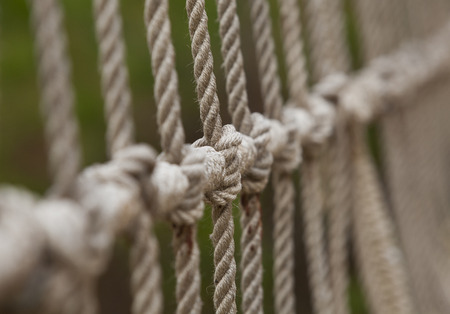 Rope with tied knot of a hanging bridge Stock Photo