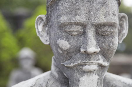 Close up of the face of stone statue, Vietnamese Guarding the tomb Sculptures of the late Kings Stock Photo