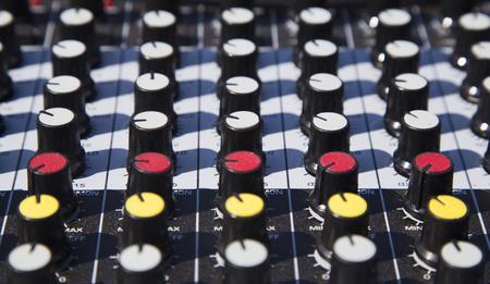 Close up of a music sound mixer at an outdoor event