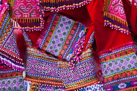Close up of colorful pattern and details textile costume of Asian ethnic.