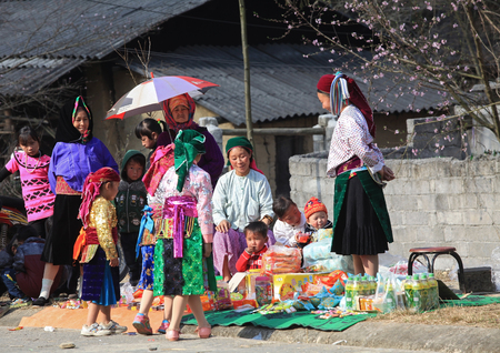 ha giang: HA GIANG, VIETNAM - FEB 7, 2014: Hmong minority people going out on a traditional holiday called Tet. On this special occasion, people wear their most beautiful and colorful suits