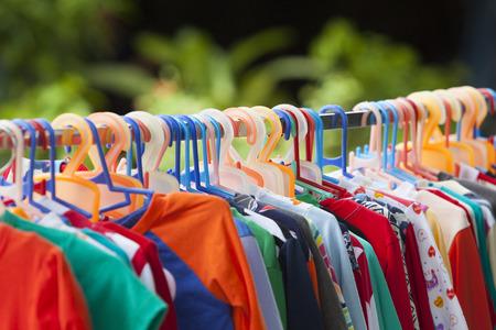 Clothes hang on a shelf