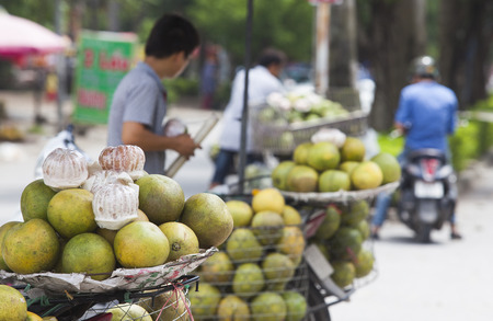 Grapefruit for sale by vendor in Asia Editorial