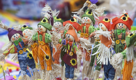 woman hanging toy: Colorful handmade puppets for sale at an old street in Hanoi quarter streets Stock Photo