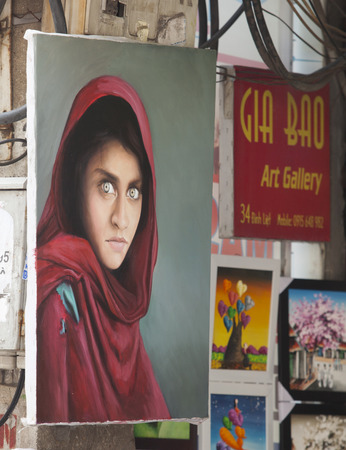 well known: Hanoi, Vietnam - Sep 27, 2015: Painting copy of a well known editorial photo for sale at a small art gallery in Hanoi old quarter street. Copyright is a big problem in the country.