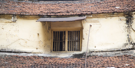 deteriorated: Close up of an old and vintage windows of a old house in Hanoi, Vietnam