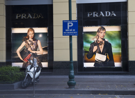 prada: Hanoi, Vietnam - Aug 29, 2016: Outdoor view of a Prada store with advertising images in Hanoi capital. Prada is an Italian luxury fashion house, specializing in leather handbags, shoes, perfumes.