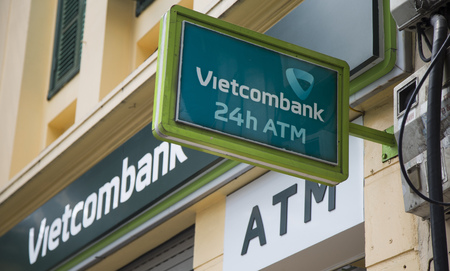 state owned: Hanoi, Vietnam - Aug 30, 2016: Close up of the logo of Vietcombank branch office on Cau Go street near Hoan Kiem (Sword) lake. Vietcombank is the one of the biggest state owned banks in Vietnam.