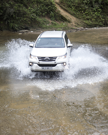 Lao Cai, Vietnam - Mar 17, 2017: Toyota Fortuner 2017 SUV in a test drive for ability on multi terrains in the far north of Vietnam. Editorial
