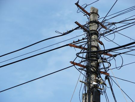 derivation: Column of air distribution of electric cables of middle tension and telephone     Stock Photo