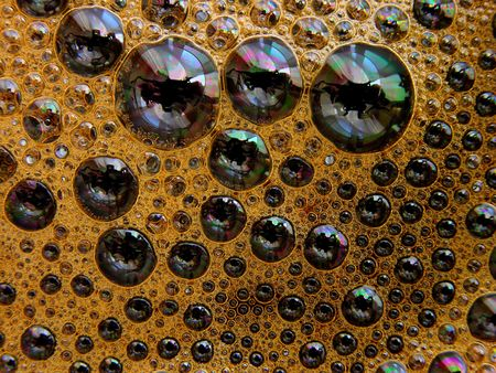 Coffee with colourful foam bubbles,