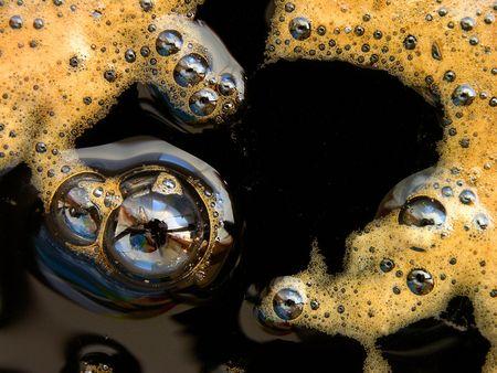 Black coffee with foam bubbles