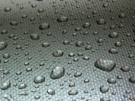 stell: water droplets on metal, grey background, stell