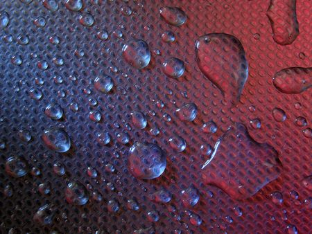 water droplets on metal, colourful background, stell
