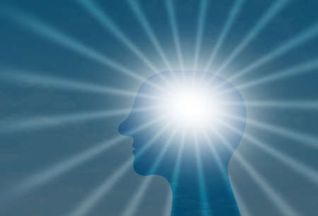 Man head Shiltuette In front of sun rays in blue sky, Brain positive energy Concept
