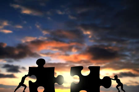 Man and Woman Connect two Puzzle Together. Businessman and businesswoman collaboration Concept , Business Couple Work Together Pushing hard to connect jigsaw pieces in front of sunset sky