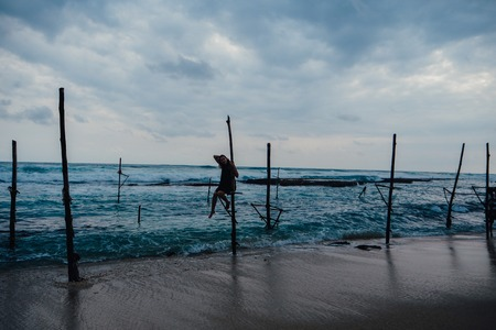 Local fisherman on stick on a beach of Indian ocean, Sri Lanka