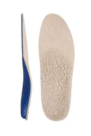 Isolated orthopedic insole on a white background. Treatment and prevention of flat feet and foot diseases. Foot care, comfort for the feet. Wear comfortable shoes. Medical insoles. Flat Feet Correction.