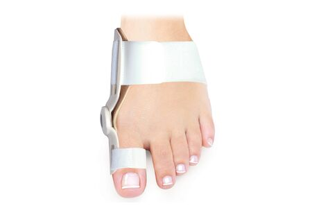 Hallux Valgus Orthopedic Medical Thumb Brace isolated on white background. Orthoses for toes.