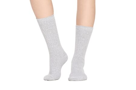 Blank white socks design mockup, isolated, clipping path. Pair sport crew cotton sock wear mock up. Long clear soft cloth stand presentation. Men basketball, football, tennis plain apparel template.