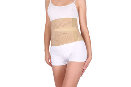 Orthopedic lumbar corset on the human body. Back brace, waist support belt for back. Posture Corrector For Back Clavicle Spine. Post-operative Hernia Pregnant and Postnatal Lumbar brace after surgery.