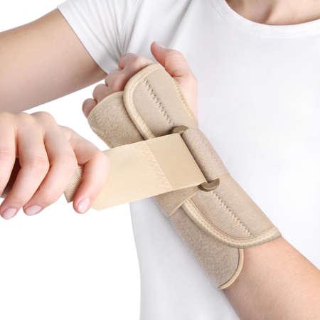 Elastic Wrist Bandage. Orthopedic medical Fitness Hand Bandage. Elastic Wrist Injury Support. Sport Protective Wristband Isolated on white background. Wrist Positioning Orthosis. Wrist pain. Standard-Bild