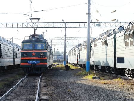 electric locomotive in the railway depot in sunny weather Фото со стока