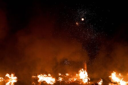 The big blazing fire in black night looks like a space galaxy with many stars