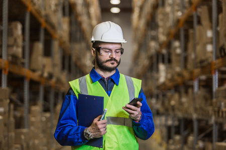Warehouse worker using mobile phone
