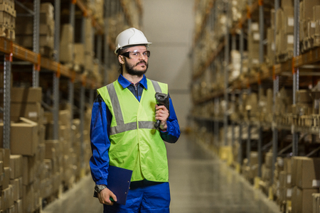 scaner: Warehouse worker with scaner looking at camera Stock Photo