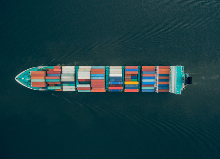 Top view of container vessel in the sea