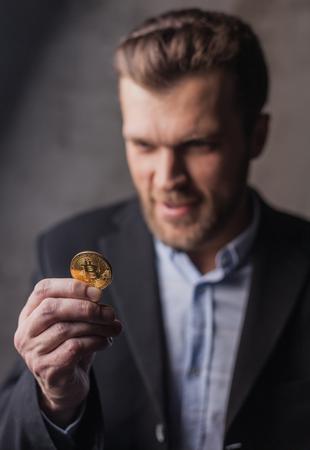 Greedy man looking at bitcoin