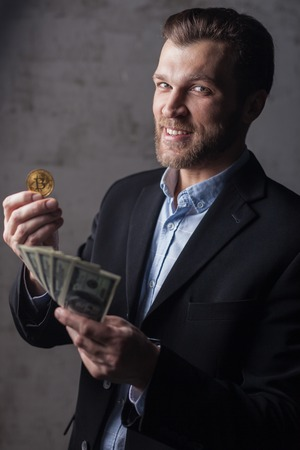 Man holding money and bitcoin Stock Photo