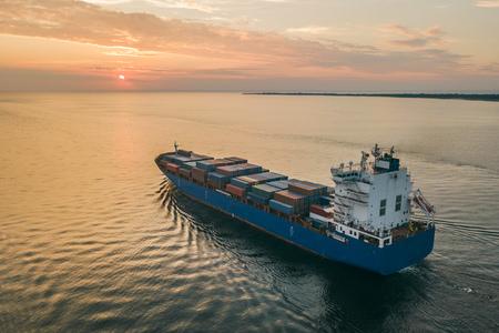 Container ship sailing in sea Standard-Bild
