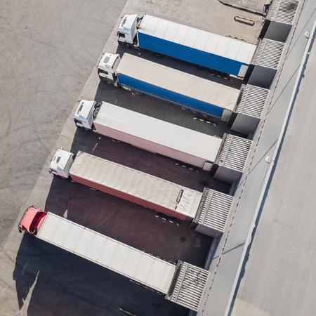 Trucks unloading in logostics center Stock Photo