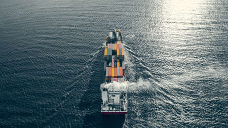 Container ship sailing in sea 스톡 콘텐츠