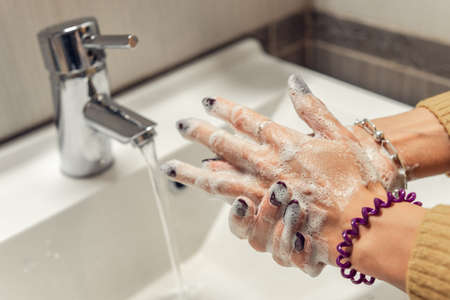 Close-up of washing hands with soap