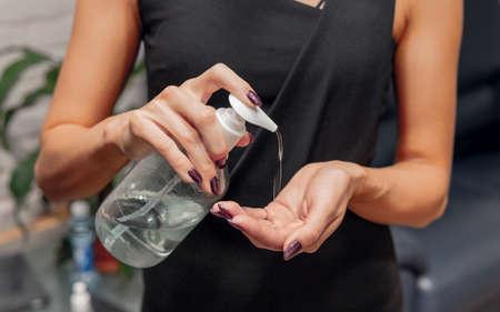 Woman uses sanitizer 스톡 콘텐츠