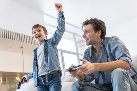 Father and son have fun together