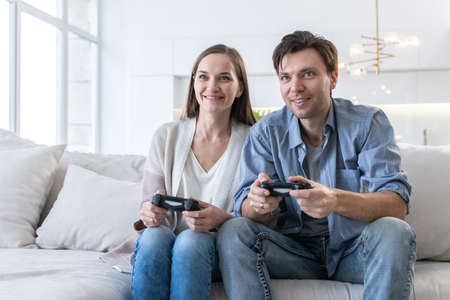Couple plays video game at home 스톡 콘텐츠
