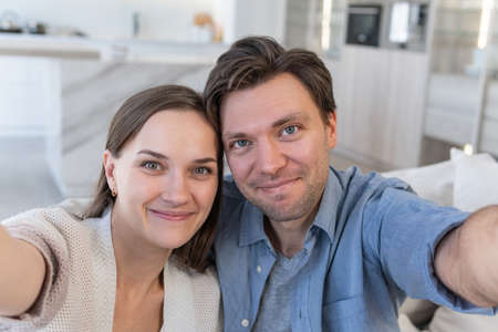 Self-portrait of cheerful couple