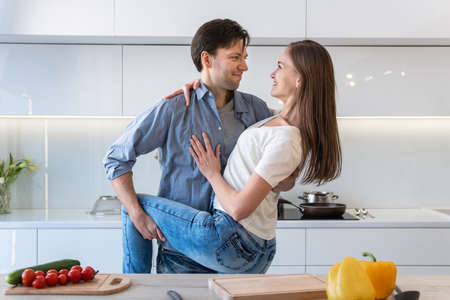 Cute couple hugging in the kitchen 스톡 콘텐츠