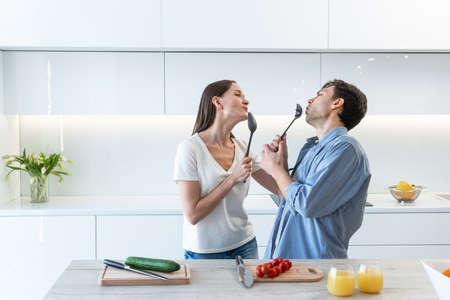 Cheerful couple having fun in the kitchen