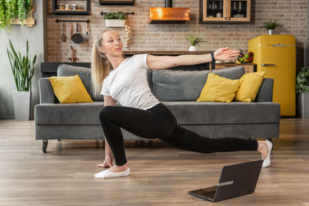 Woman does stretching exercises