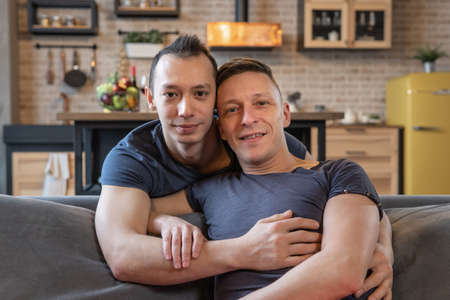 Happy male gay couple hugging 스톡 콘텐츠