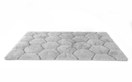 Furry carpet with honeycomb texture, isolated on white background. Interior element. 3d render Stockfoto